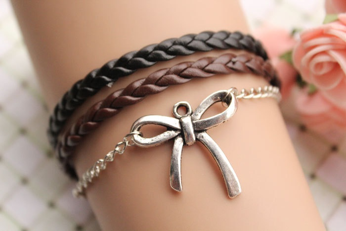 butterfly tie bracelet,retro silver butterfly tie pendant alloy bracelet,black and brown leather braid bracelet---B121, via Etsy.