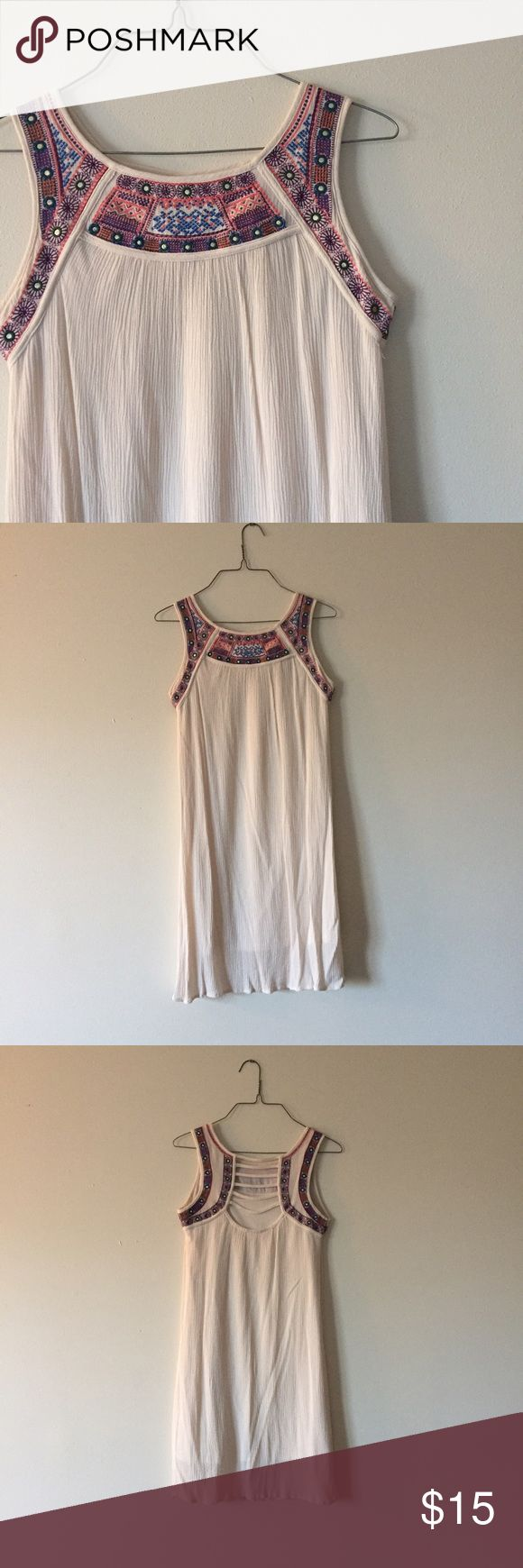 Beautiful boho shift dress with aztec accents Beautiful boho sleeveless shift dress with bright aztec design around neck and open cage back. In excellent condition and perfect for any occasion or upcoming spring or summer event Xhilaration Dresses