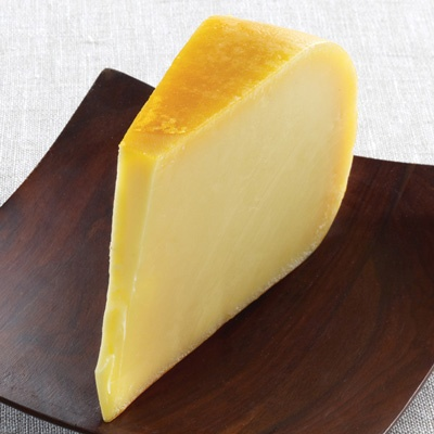 Coolea.  Irish gouda! Made from cow's milk. Sweet, caramely/tofee-like, and firm. Crystals pop up at 18 months.