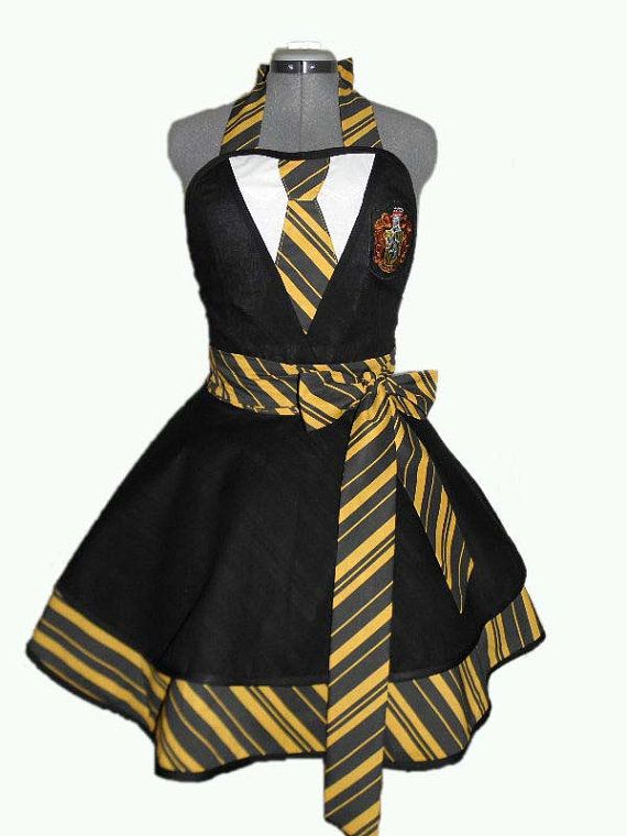 For the fans of Helga Hufflepuff, here is the Hufflepuff House Retro Apron (pictured with Gryffindor as a sample, since I havent made this one as of yet). Entertain your friends, bake up a storm, or dress up for a Harry Potter cosplay event in this adorable, figure flattering retro apron. Shown in following fabric pictures in Hufflepuff House gold and black, these apron ties are extra long so it can be tied in the front or in the back. A Hufflepuff patch adorns the front bodice. Shown with…