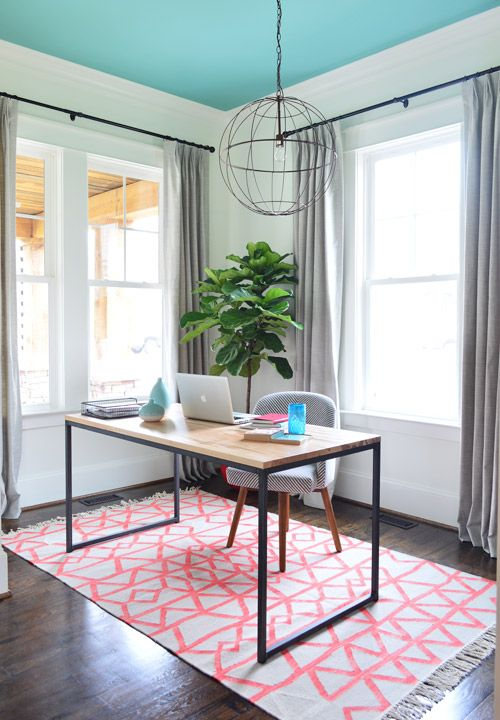 Feminine office with metal pendant, teal ceiling, and pink rug. Business, Bedding, & Butlering | Young House Love