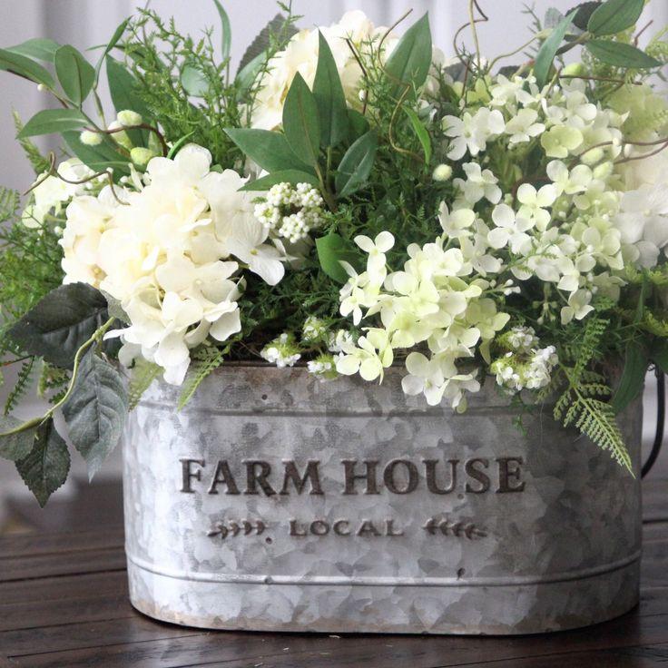 Green & creamy white hydrangeas in a very popular farm house galvanized pail.
