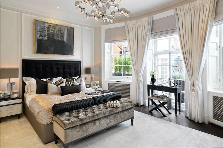 Bedroom - black velvet headboard, crushed velvet ottoman and bespoke radiator covers with silver grills. Contemporary chrome chandelier. Scatter cushions