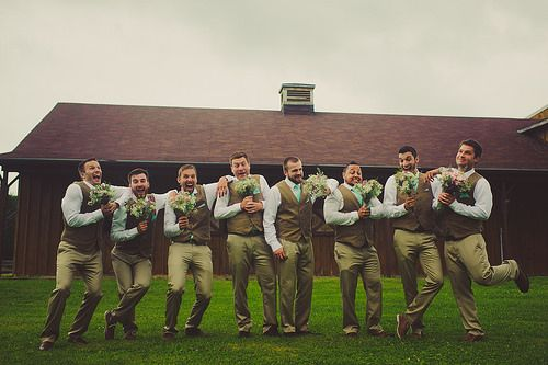 #groom and #groomsmen in white #shirt , #tan #trousers , warm earthy tone #vest and matching #turquoise #tie and #pocketsquare having a fabulous time holding #wedding #bouquets :) See more at http://www.wellgroomedblog.com/2016/01/well-groomed-groom-patterned-vest-and.html