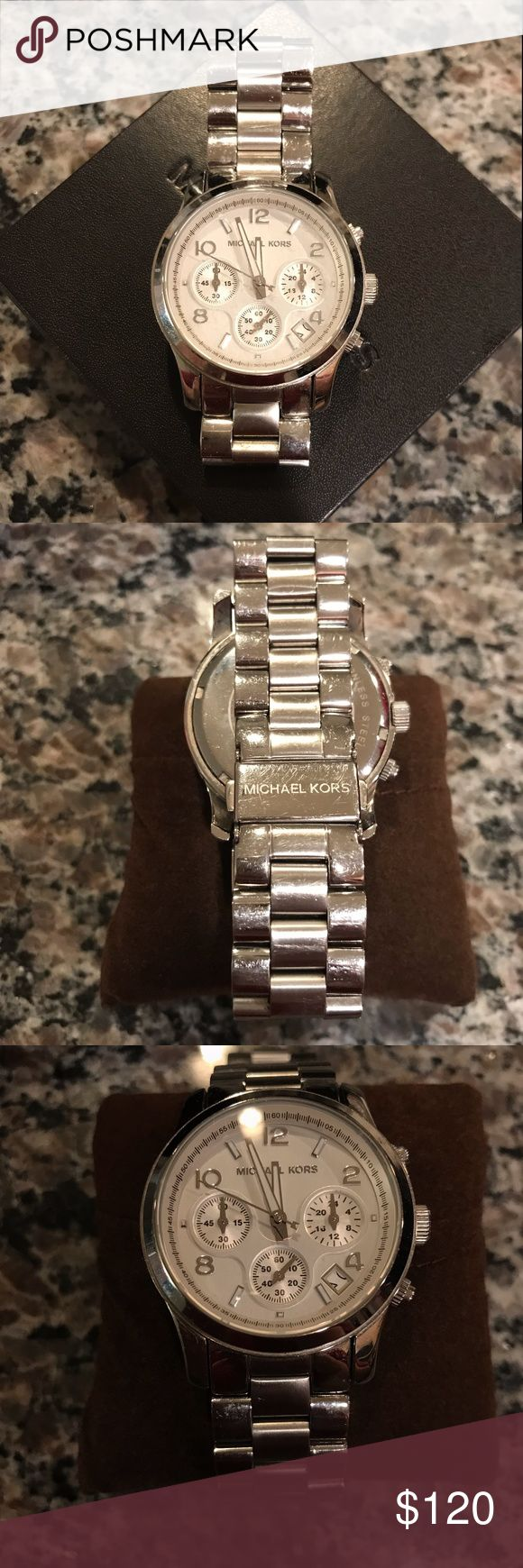 Michael Kors Silver Watch Michael Kors watch in silver. Worn but comes with the tags and all links! This watch would make a GREAT Christmas gift. Michael Kors Accessories Watches