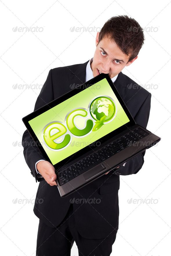 A businessman bites a laptop with eco sign ...  adult, background, box, business, businessman, businessperson, computer, copy, corporate, display, displaying, earth, eco, editable, excited, excitement, executive, hispanic, isolated, laptop, man, peaceful, people, person, planet, point, recycle, recyclers, screen, smile, smiley, space, sphere, suit, tech, technology, text, white, young