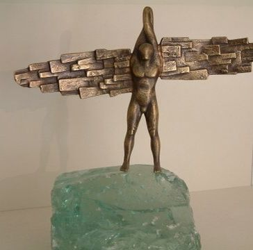 Angel. Patinated bronze, glass. Signed. Dimensions: 20x22cm
