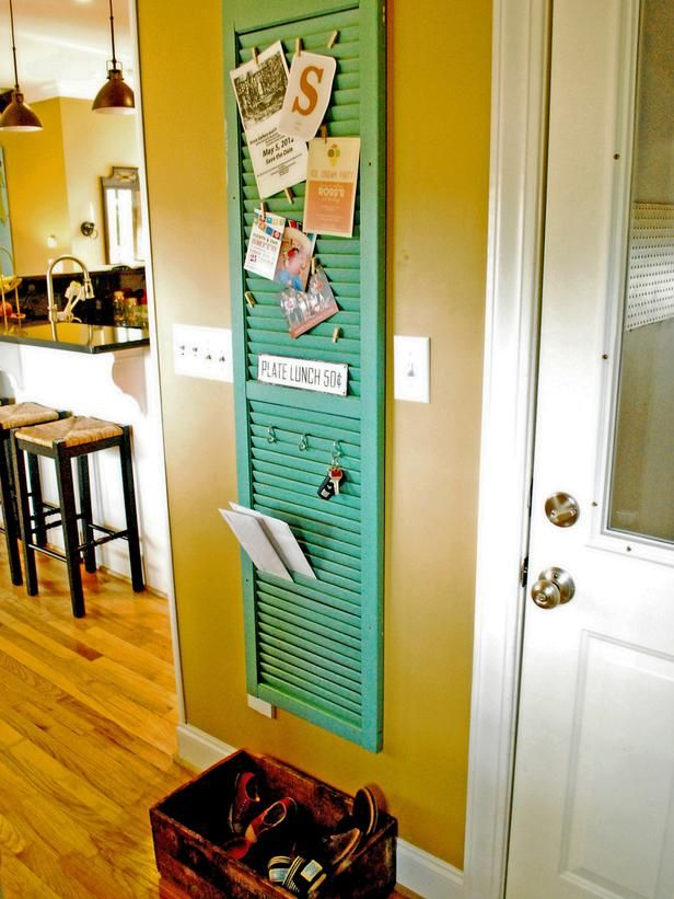 Conquer entryway clutter by turning a vintage shutter into an organization system. Place S hooks and clothespins on the wooden slats to hold everyone's keys and outgoing mail, invitations and other important memos. Now there's no excuse for missing keys, lost invites or misplaced bills.