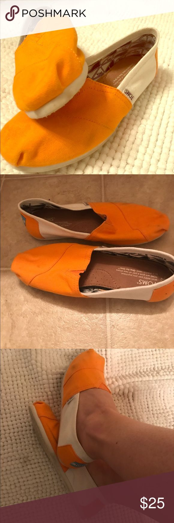 Orange and White Classic Canvas Toms Awesome spin on the classic Tom. I bought them to wear to a University of Tennessee game. TOMS Shoes Flats & Loafers