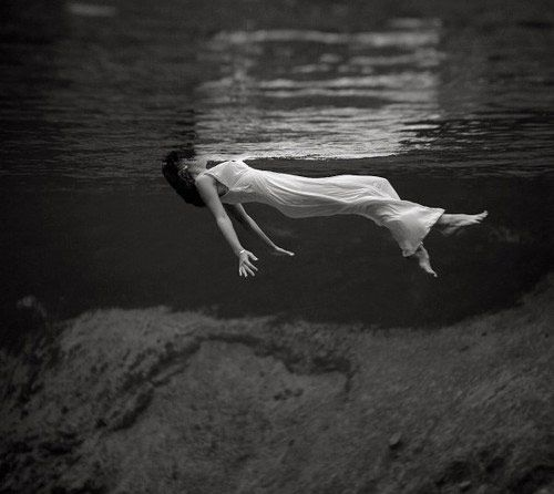 I like this photo because of its exemplary use of color, even in a black and white setting. The white dress contrasts substantially with the rest of the darker background and creates a definitive focal point. I also like that the photo is taken underwater, which distorts the horizon line and leaves the woman suspended in the 'air.' The texture created by the water surface (compounded with the reflection of the white) is another element that gives the photo an added dimension.