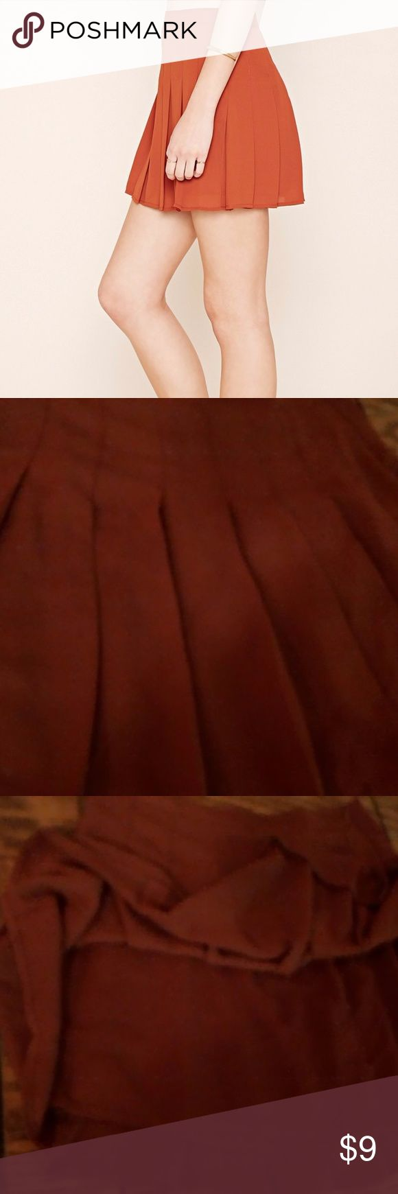 """Pleated Mini Skirt rust medium *USED*LIKE NEW*  - A woven mini skirt featuring allover pleating with an invisible side zipper. Content + Care - Shell & Lining: 100% polyester - Hand wash cold - Made in China ***COLOR PICK SAYS ORANGE BUT IT'S MORE LIKE """"BURNT"""" ORANGE...RUSTY COLOR***  THANKS FOR LOOKING<3 Forever 21 Skirts Mini"""