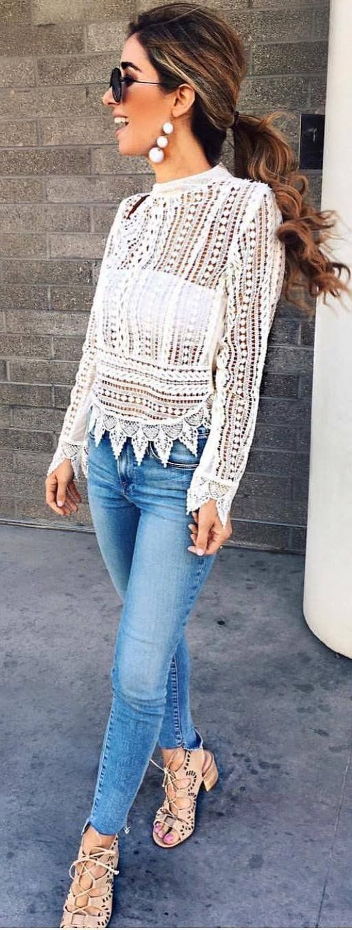 Cute white lace top with denim jeans.