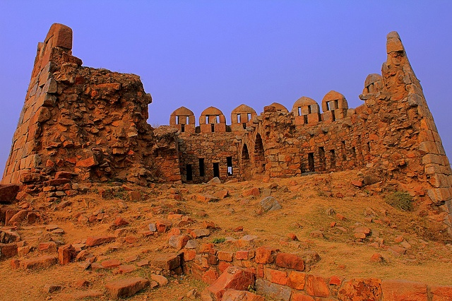 Tughlaqabad Fort is a ruined fort in Delhi, stretching across 6.5 km, built by Ghiyas-ud-din Tughlaq, the founder of Tughlaq dynasty, of the Delhi Sultanate of India in 1321 .