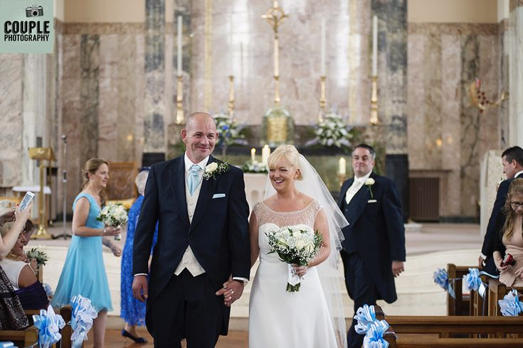The newly married couple walk down the aisle together. Weddings at The Johnstown Estate, photographed by Couple Photography.