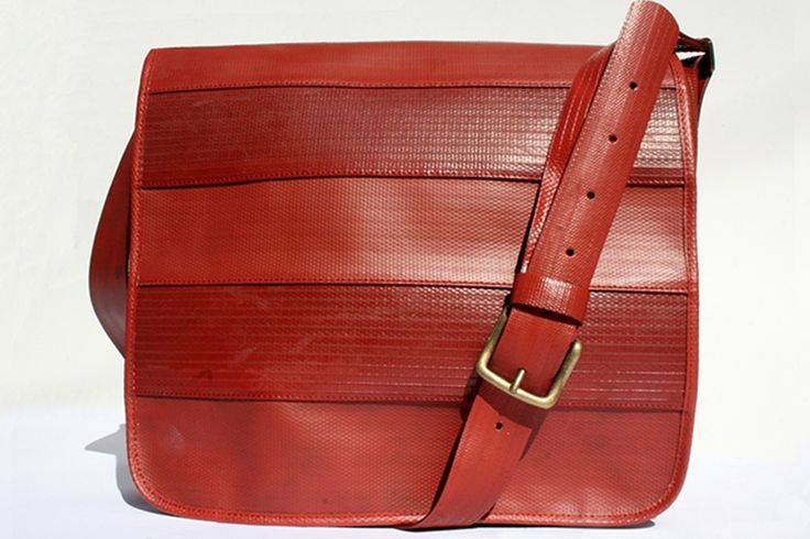 The Elvis & Kresse Messenger Bag is made from genuine decommissioned fire-hose and has a reclaimed military-grade parachute silk lining.