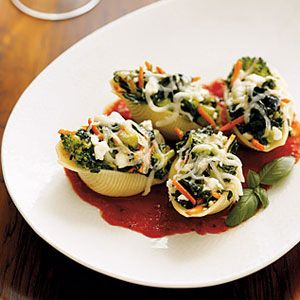 To create a lighter, healthier version of stuffed shells, the standard whole milk ricotta cheese filling is replaced with frozen leaf spinach and lowfat cottage cheese or part-skim ricotta, which cuts down the fat without sacrificing creaminess.