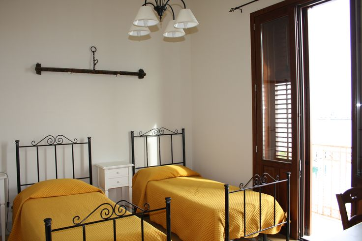 Capitano #Suite of #B&B Belveliero is constituted by two interconnected rooms, ideal for four people. Decorated with pieces of an ancient #sicilian cart, these rooms have a suggestive frontal view of the #Trapani port to appreciate to the best of the sight of #Egadi Islands and Colombaia #Castle www.bebtrapanilveliero.it