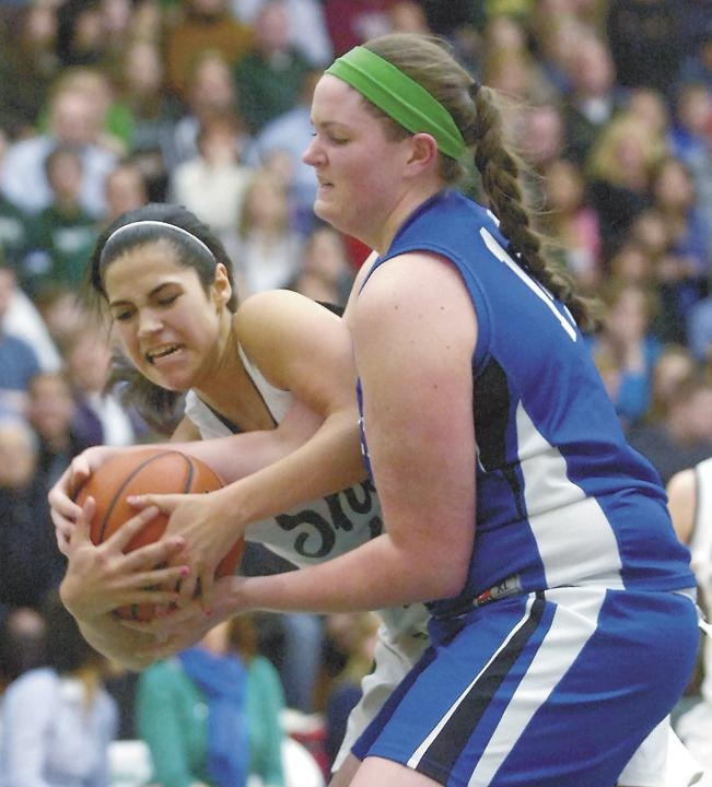 Shenendehowa's Alyssia Marsal battles with Shaker's Julia Holland for the ball during third quarter of high school girls basketball action Thursday, January 10, 2013 at The ARC at Siena College in Loudonville. The game was to benefit the Christopher F. Stewart and Deanna M. Rivers Scholarships. (J.S. Carras / The Record)