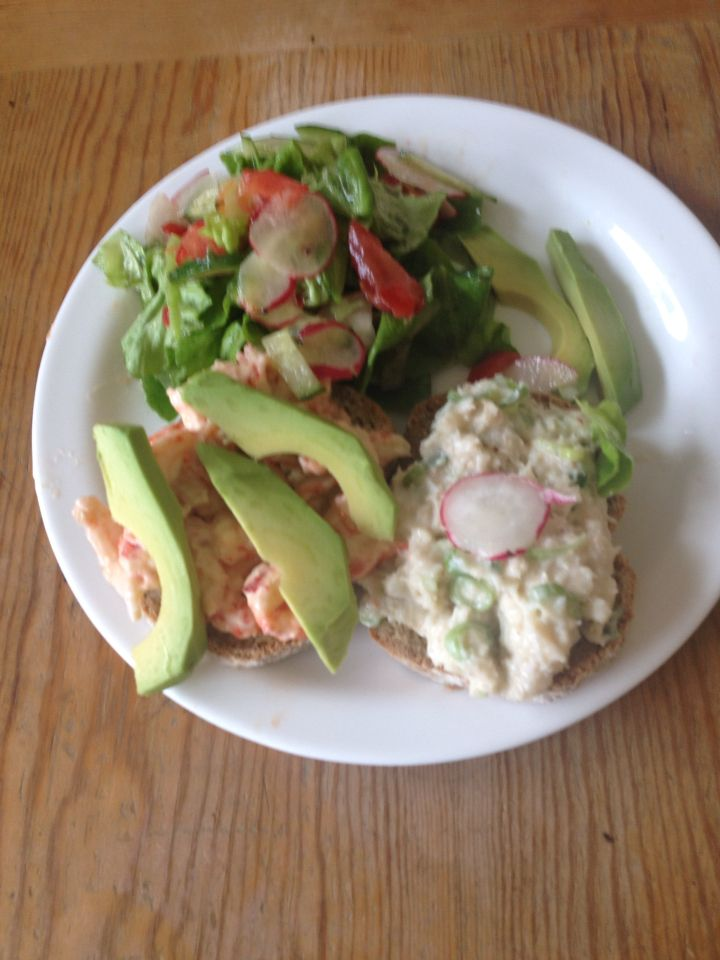 Crab and crab fish on brown bread with salad