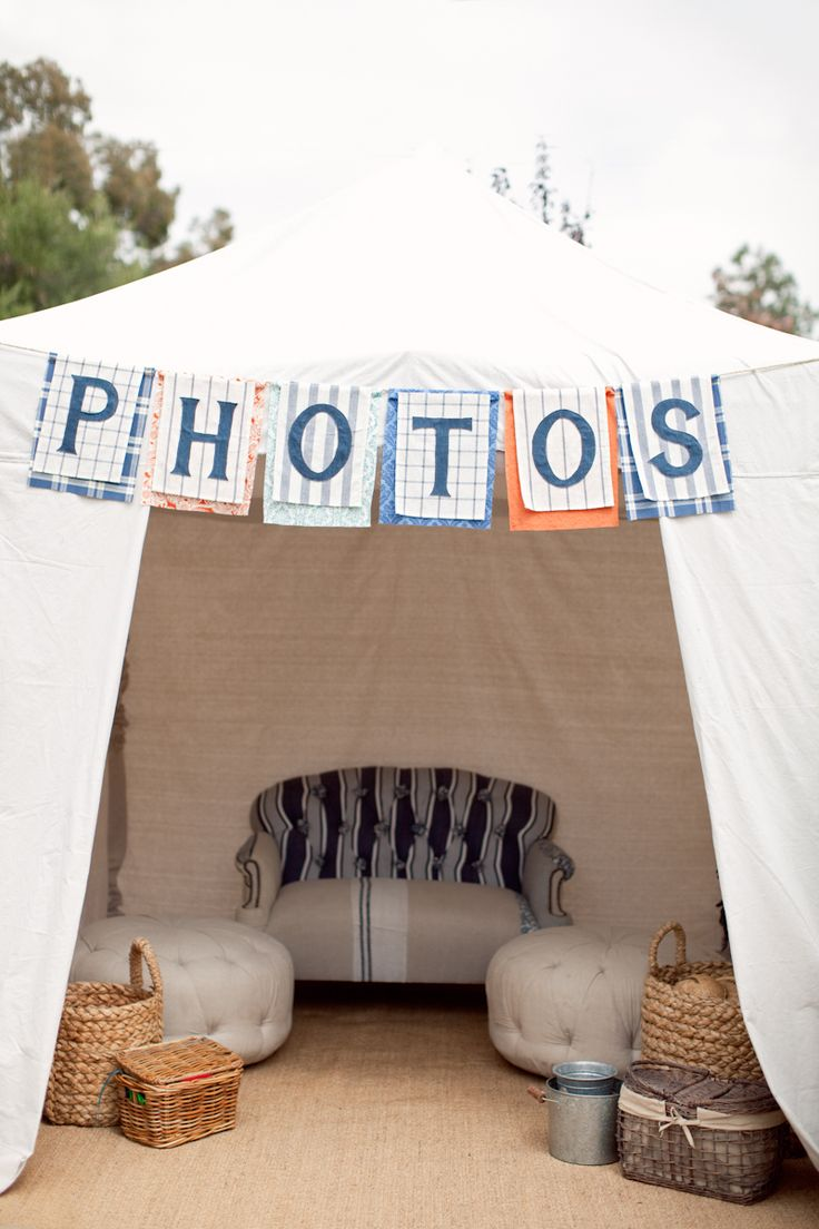 Cute photo tent - perfect for outdoor daylight weddings so people aren't squinting!