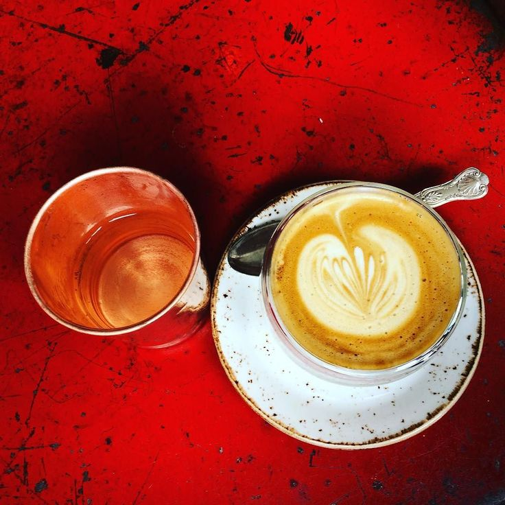 Flat white in glass cup water in copper tumbler at Gather in Bath @gathercafe Great quirky little cafe serving good coffee and small but tasty menu. #flatwhite #coppermug #quirkystyle