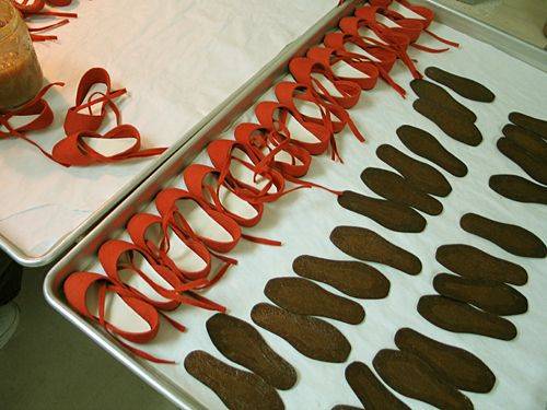 R. John Wright Dolls - Production of Queen of Hearts. Shoe uppers receive their leather soles. #RJWDolls #RJohnWrightDolls #CollectibleDolls