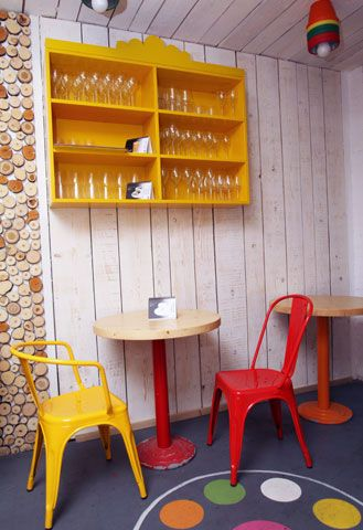Red & yellow Tolix chairs at Gelato mio, a cute and cheerful ice cream cafe in Bucharest, Romania