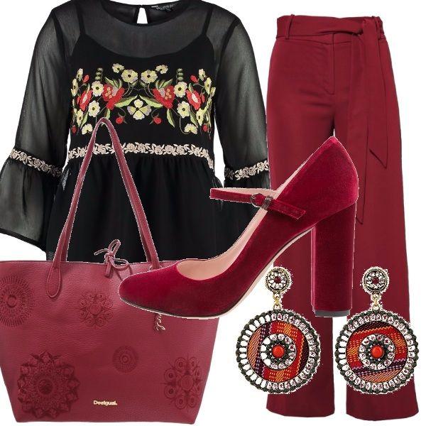 Tessuti leggeri per gli elementi di questo outfit: pantaloni ampi con fusciacca in vita, casacca con un bel ricamo. Gli accessori sono tutti bordeaux: le scarpe con cinturino e la shopping bag e gli orecchini a cerchio.