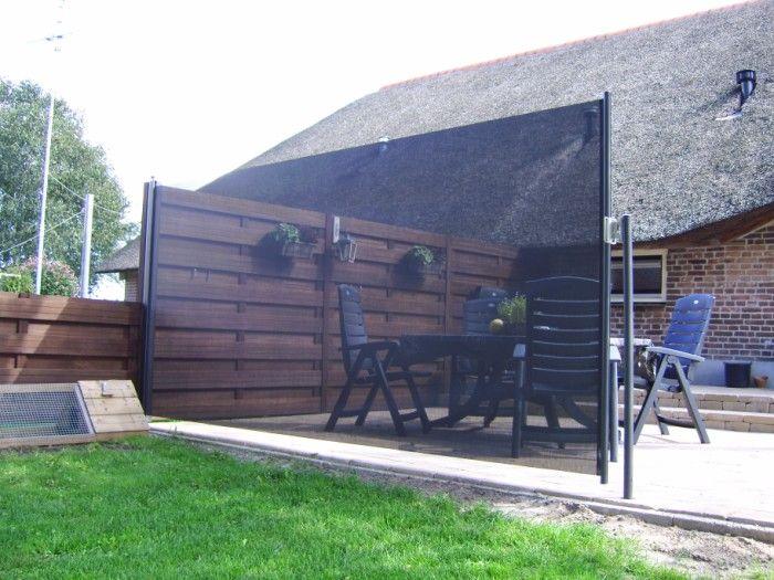 Oprolbaar windscherm in Tuin | Terras-Windscherm.nl - Trendo Externo | Buitenleven - Windschermen | Buitentapijten | Buitengordijnen | Terrasheaters | Zonneluifels