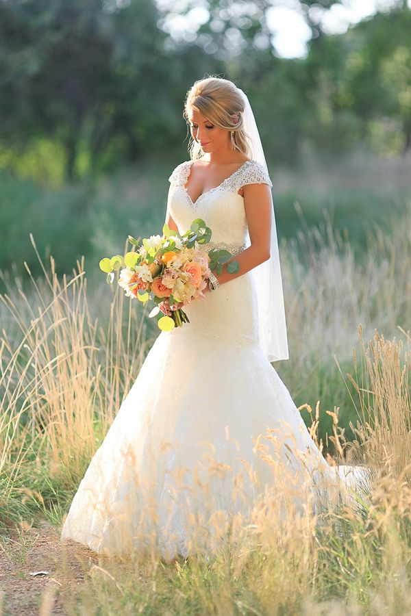 cap sleeved wedding gown | lovely portraits in field