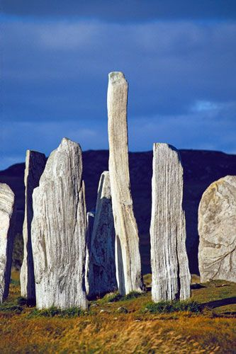 The Callanish stone ring on the Isle of Lewis in Scotland is a megalithic ruin dating from 3400 BC.
