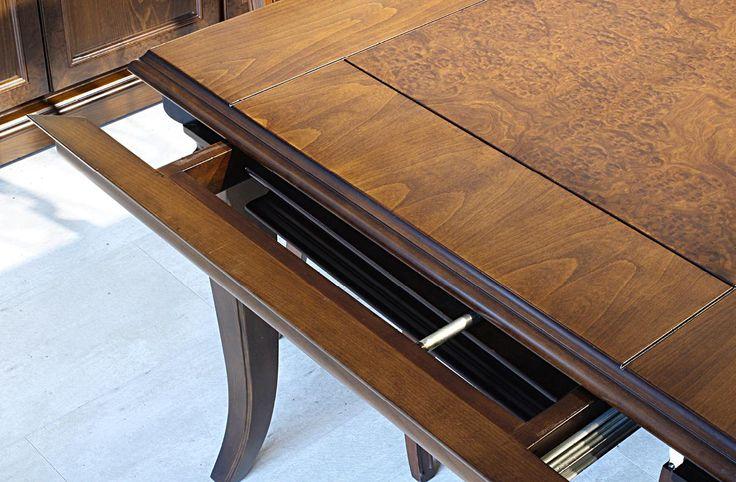 Σετ τραπεζαρίας κατασκευασμένο από φυσικό ξύλο καρυδιάς και ρίζα καστανιάς που αποτελείται από:Τραπέζι διαστάσεων 1,70χ1,00 με ένα φύλλο προέκτασης 45cm.Μπουφές διαστάσεων 2,00χ0,50χ0,95 που συνοδεύεται από έναν καθρέπτη κατασκευασμένο από φυσικό ξύλο καρυδιάς διαστάσεων 1,85χ1,00Όλα τα συρτάρια και οι μηχανισμοί των προεκτάσεων είναι Ευρωπαϊκής προέλευσης τηλεσκοπικοί υψηλής αντοχής.