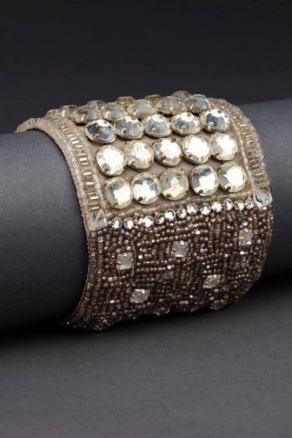 Andrea Gutierrez - Renowned for her intricate and detailed cuffs that incorporate reclaimed and recycled crystals, glass beads, pearls, beads of every type and metal chain links, each one entirely different and unique.