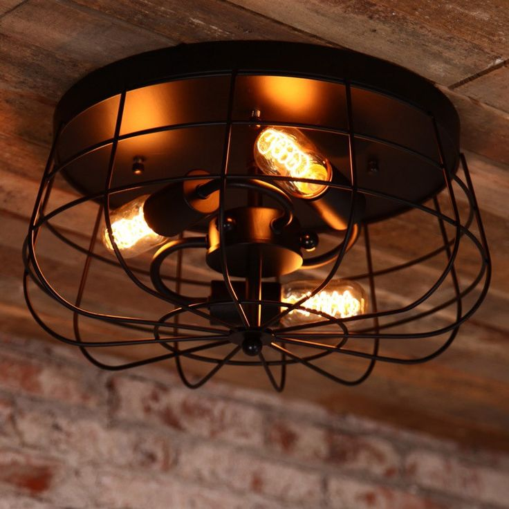 Inspired Of The Old Wire Caged Bathroom Fans This Semi Flush Mount Adds A Striking Touch