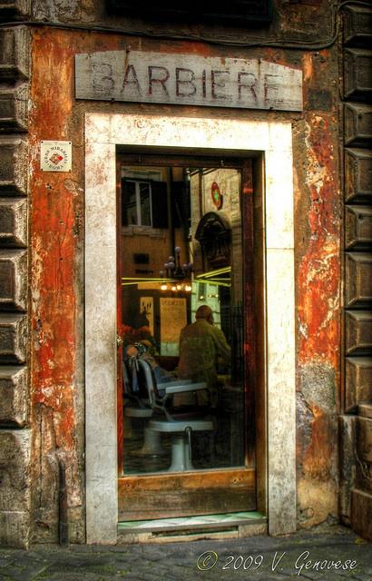 Barber shop door in Italy . Love to just pop my head in