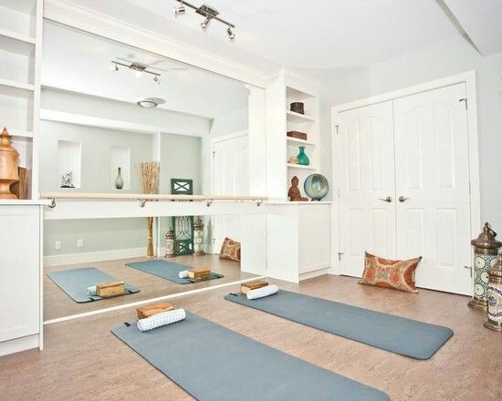 Yoga Room with floor-to-ceiling mirror and barre.  I would love to have a spare room with this kind of yoga/dance corner, and a place for hand weights and resistance bands, maybe even a stationary bike.  Throw a writing desk in one corner and I'd be set!  It would be the ME TIME room.