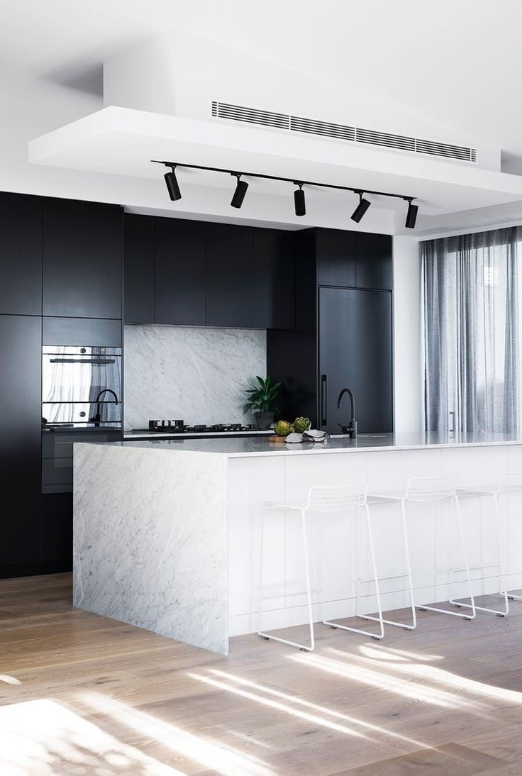 Black & marble kitchen Marble Overhang