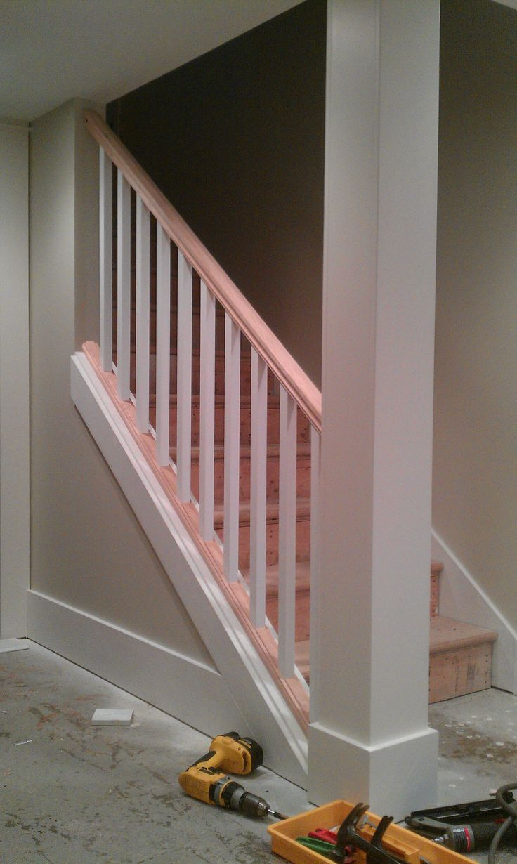 basement stair removing part of the wall and replacing it with spindles and handrail makes