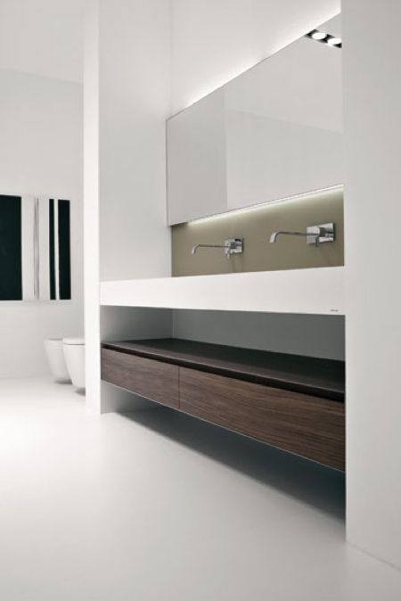 minimal contemporary bathroom. Look at those sink faucets.