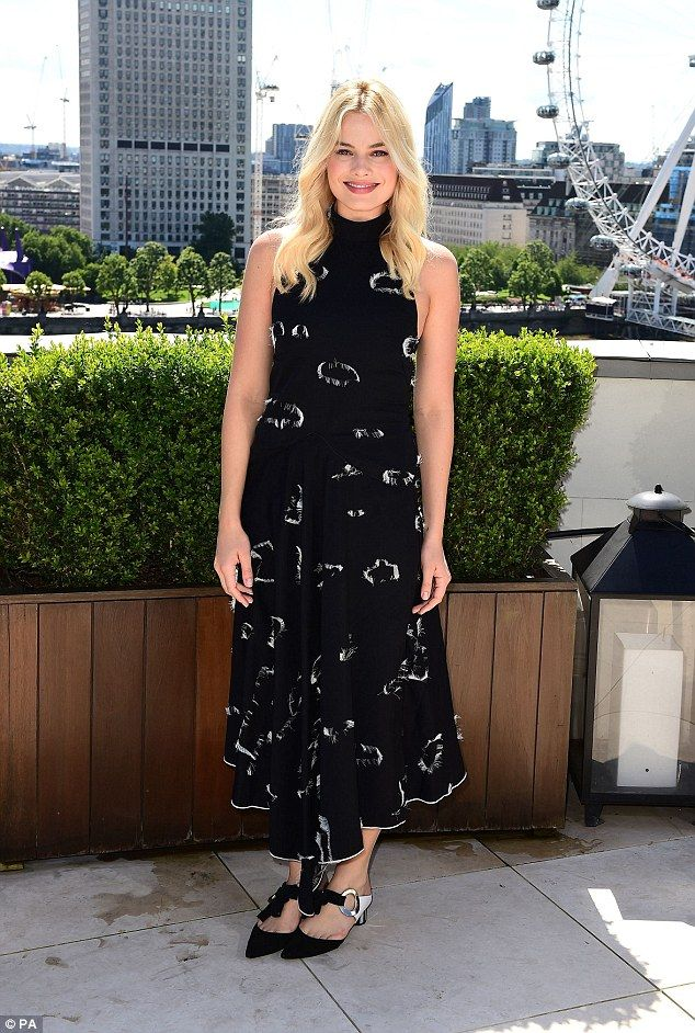 In the big smoke: Margot Robbie proved herself yet again to be a stunner as she blazed The Legend Of Tarzan promotional trail alongside her co-star Alexander Skarsgård in London on Monday