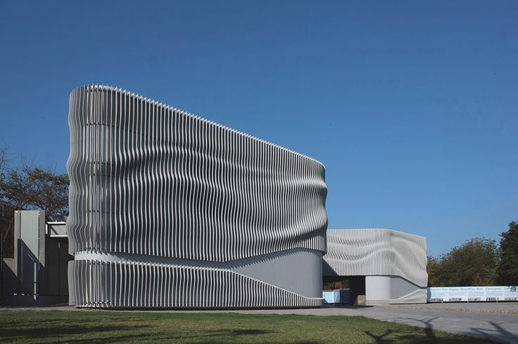 Apical Reform's self-designed new headquarters are distinguished by a striking slatted facade that serves dual purposes. Visually, it creates a soft fabric-like illusion as