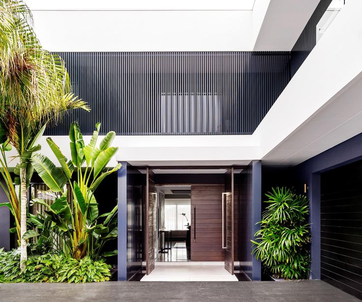 Contrasting white, bright and open spaces with areas of dark moody glamour lifts the tempo in this Gold Coast waterfront home. Photography: Justin Alexander | Story: Belle