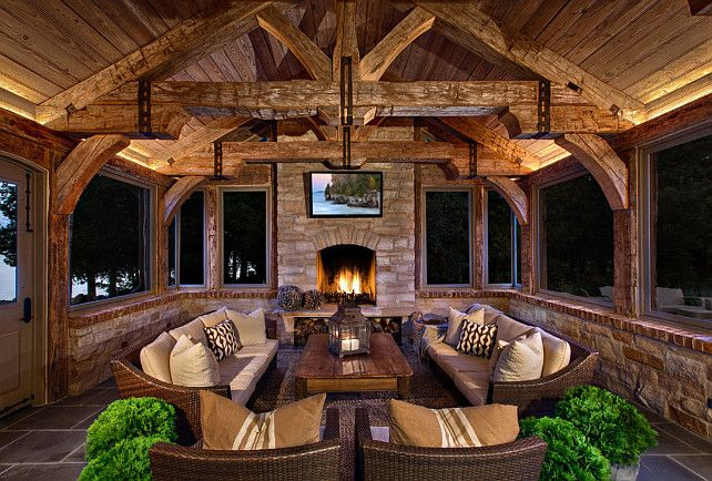 This sunroom is rustic yet very inviting. The perfect place to curl-up by the fire on a chilly night.