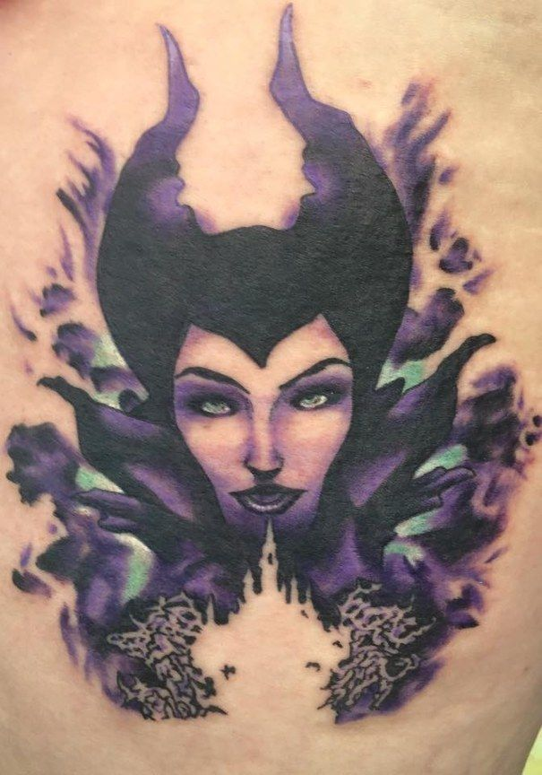 Maleficent, with an outline of the Disney castle. | 41 Disney Tattoos That'll Make You Want To Get Inked