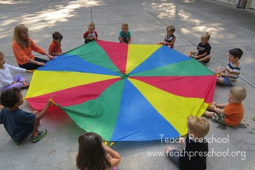 Parachute playing teaches that you need teamwork and to work together. They can also use motor skills waving the parachute high and can play multiple games where they can have fun and learn.