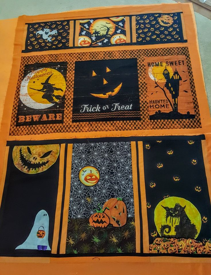 The Halloween Quilt  The middle section is a panel, I search the free clip art for the other squares. Now I have a Halloween Quilt with my favorite Halloween clip art. :}The backside is a  bright orange fleece.