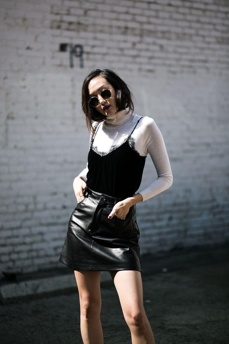 White turtleneck, lace cami, black leather skirt.