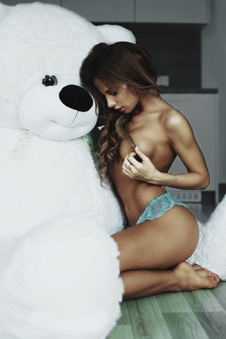 hot girl playing with a teddy bear