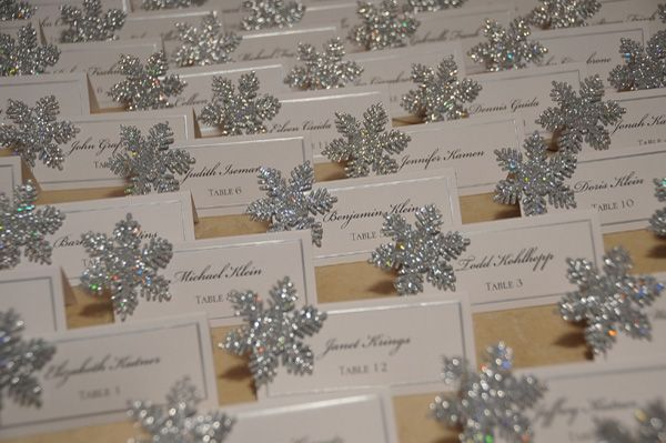 Place Cards Place cards adorned with glittering snowflakes.