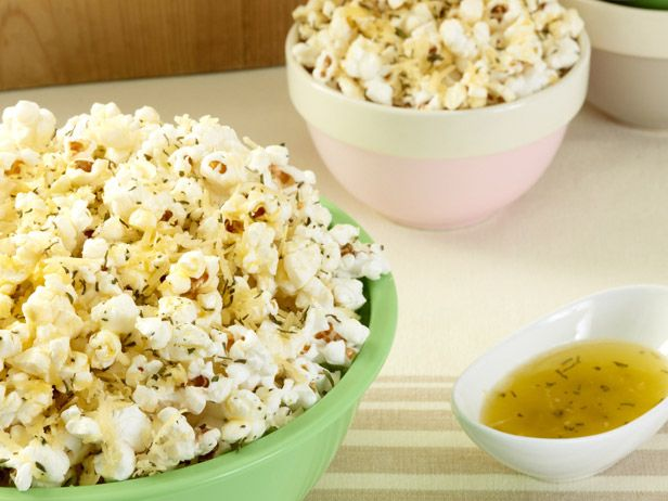 Make tonight movie night at home and serve Giada's Cheesy Popcorn. She pops the kernels on the stove, then tosses them with herbed garlic butter and plenty of Asiago cheese for an indulgent snack. #RecipeOfTheDay: De Provence, Cheese Recipe, Food Network, Giada De Laurentiis, Herbs Popcorn, Chee Recipe, Asiago Cheese, Snacks Recipe, Herbs De